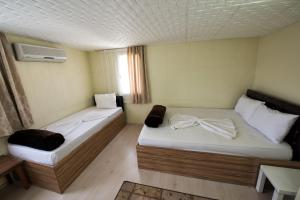 Yellow Rose Pension, Privatzimmer  Canakkale - big - 47