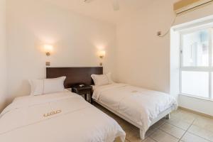 UGO Apartment Sanyabay Branch, Ferienwohnungen  Sanya - big - 17