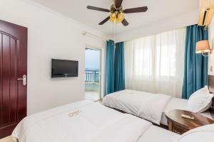 UGO Apartment Sanyabay Branch, Ferienwohnungen  Sanya - big - 35