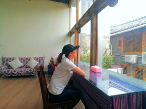 Flower Mirage Inn, Guest houses  Lijiang - big - 41