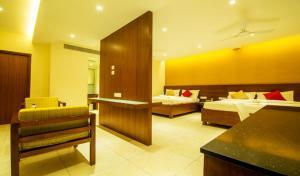 Gayathri Hotels, Отели  Tiruppūr - big - 10
