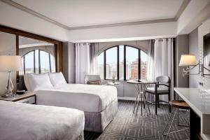 Guest Room with Two Queen Beds and City View