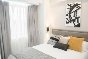 Short Term Rentals Makati Parkplace, Apartmány  Manila - big - 109