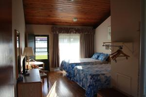 Room with Two Beds and Parquet Floor