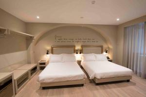 Caruso Place Boutique & Wellness Suites - AbcAlberghi.com