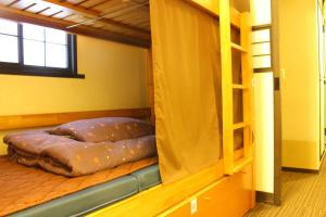 Bunk Bed in 4-Bed Mixed Dormitory Room with Curtain