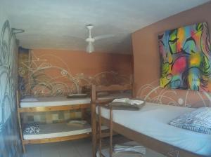Cama en habitación mixta compartida de 6 camas