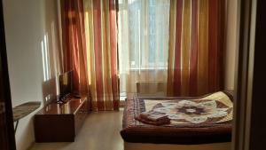 Kvartira v ZhD raione, Апартаменты  Улан-Удэ - big - 5