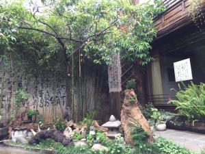 Lijiang Shuhe Qingtao Inn, Penziony  Lijiang - big - 131