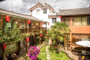 Lijiang Shuhe Qingtao Inn, Penziony  Lijiang - big - 1