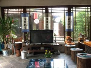 Lijiang Shuhe Qingtao Inn, Penziony  Lijiang - big - 128