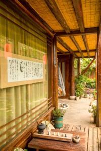 Lijiang Shuhe Qingtao Inn, Penziony  Lijiang - big - 114