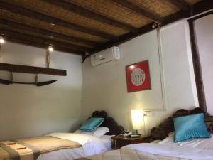 Lijiang Shuhe Qingtao Inn, Penziony  Lijiang - big - 47