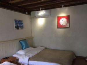 Lijiang Shuhe Qingtao Inn, Penziony  Lijiang - big - 53