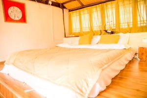 Lijiang Shuhe Qingtao Inn, Penziony  Lijiang - big - 61