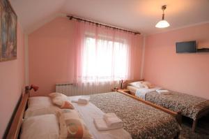 Rooms Family Glumac, Гостевые дома  Езерца - big - 21