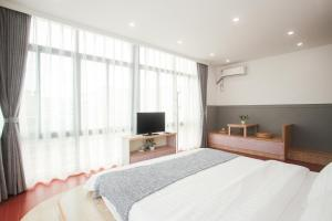 Xiamen Aishang Inn, Homestays  Xiamen - big - 26