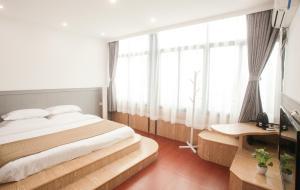 Xiamen Aishang Inn, Homestays  Xiamen - big - 27