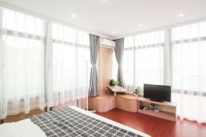 Xiamen Aishang Inn, Homestays  Xiamen - big - 28