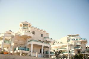 Penthouse Familial- Jacuzzi - La Palmeraie, Apartmanok  Eilat - big - 1