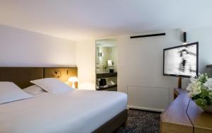 Hotel Marignan Champs-Elysées, Отели  Париж - big - 54