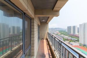 Aiqinhai ApartHotel, Апартаменты  Jinzhou - big - 46