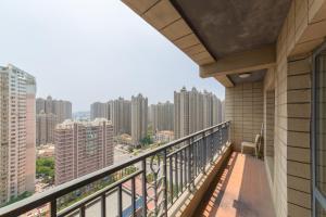 Aiqinhai ApartHotel, Апартаменты  Jinzhou - big - 47