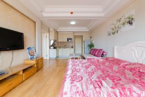 Aiqinhai ApartHotel, Апартаменты  Jinzhou - big - 39