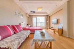 Dalian Aegean Sea Apartment, Apartmanok  Csincsou - big - 2