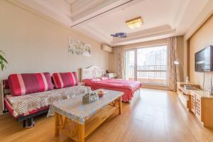 Dalian Aegean Sea Apartment, Apartmanok  Csincsou - big - 3