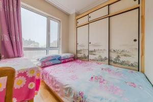 Dalian Aegean Sea Apartment, Apartmanok  Csincsou - big - 33