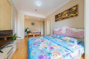 Aiqinhai ApartHotel, Апартаменты  Jinzhou - big - 35