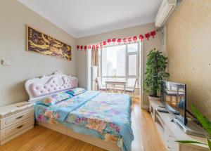 Aiqinhai ApartHotel, Апартаменты  Jinzhou - big - 37