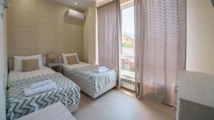 Apartamenty LIuKS na ul. Kuvshinok, 8a, Apartmány  Adler - big - 12