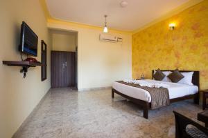 Hotel Hill Rock, Отели  Tiracol - big - 9