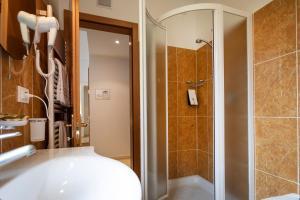 Hotel Garnì Orchidea, Отели  Мальчезине - big - 14