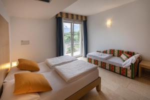 Hotel Garnì Orchidea, Отели  Мальчезине - big - 36