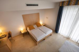 Hotel Garnì Orchidea, Отели  Мальчезине - big - 8