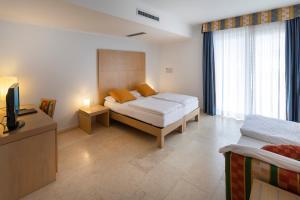 Hotel Garnì Orchidea, Отели  Мальчезине - big - 28