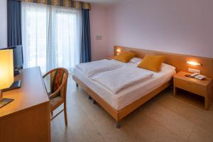 Hotel Garnì Orchidea, Отели  Мальчезине - big - 17
