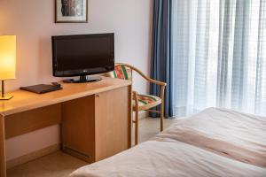 Hotel Garnì Orchidea, Отели  Мальчезине - big - 11