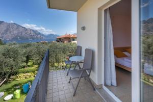 Hotel Garnì Orchidea, Отели  Мальчезине - big - 16
