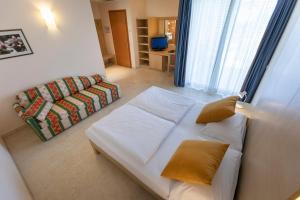 Hotel Garnì Orchidea, Отели  Мальчезине - big - 12