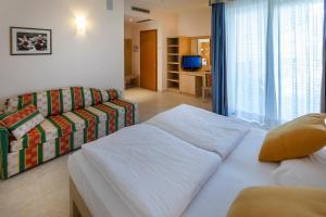 Hotel Garnì Orchidea, Отели  Мальчезине - big - 7