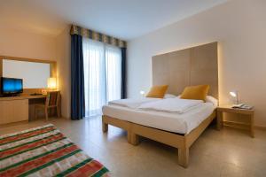 Hotel Garnì Orchidea, Отели  Мальчезине - big - 50