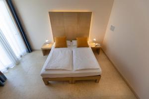Hotel Garnì Orchidea, Отели  Мальчезине - big - 18