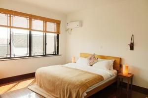Pure-Land Villa, Privatzimmer  Suzhou - big - 11