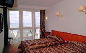 Hotel Les Arcades, Hotely  Saint-Cast-le-Guildo - big - 8