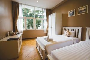 Feung Nakorn Balcony Rooms and Cafe, Szállodák  Bangkok - big - 77