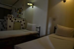 Dvoulůžkový pokoj typu Deluxe s manželskou postelí nebo oddělenými postelemi